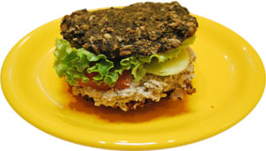 Burger WITHOUT bread made from 2 oats croquets along with nut dip between them